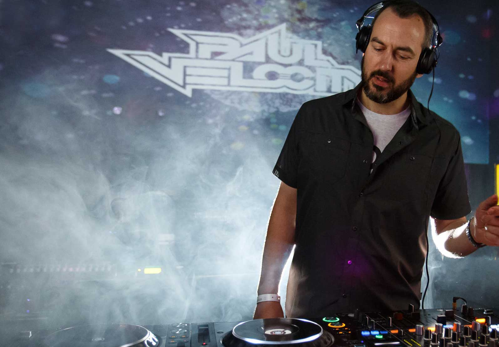 Image of DJ Paul Velocity in a nightclub behind the decks